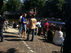 Attendees enjoying the weather by the gracht